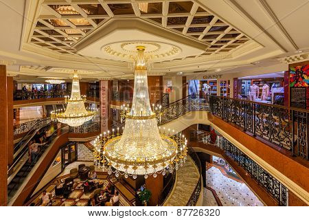 MONTE CARLO, MONACO - JULY 13, 2013: Interior view of Metropole Shopping Center with 80 luxury shops and boutiques is one of the popular tourist places to visit in Monte Carlo.