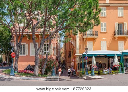 MONACO-VILLE, MONACO - JULY 13, 2013: Small restaurant and traditional colorful houses in Monaco-Ville - old town and one of the four quarters of Monaco with Prince's palace as main tourist landmark.