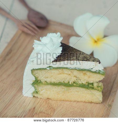 Green Tea Cake On Wooden Plate, Vintage Cake