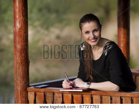 Young girl consulting the agenda in the park