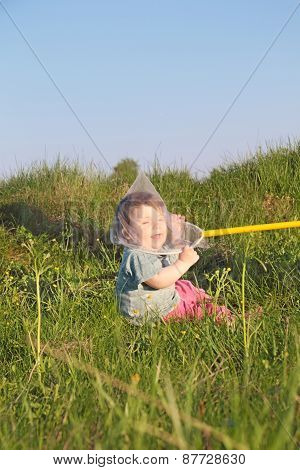 Laughing Cute Little Boy Sitting On Grass Caught Butterfly Net