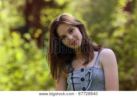 Closeup Of Beautiful Girl With Red Lips And Long Hair, Looking To Camera With Shallow Depth Of Field