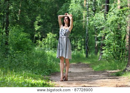 Beautiful Girl In Dress With Long Hair, Walking On Footpath In Woods