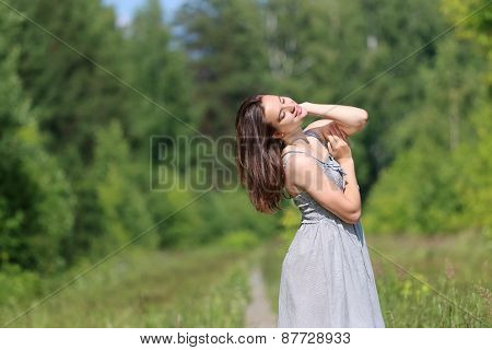Beautiful Girl In Dress Standing On Footpath Surrounded By Woods
