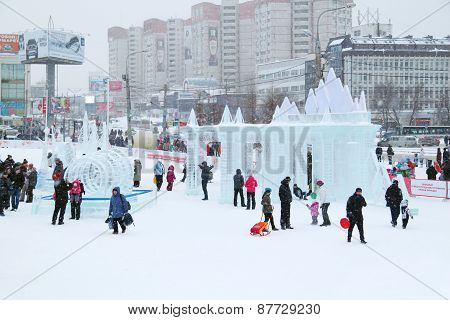 Perm, Russia - Jan 1, 2014: People In Ice Town At Snowy Day. Construction Of Ice Town Worth 268,000
