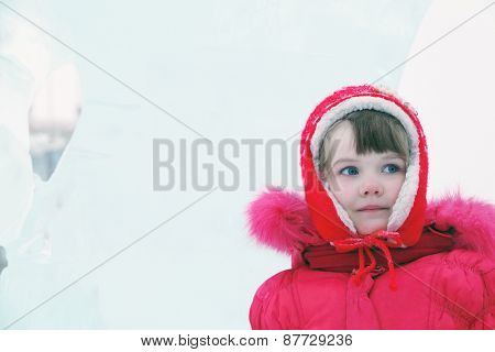 Little Happy Girl In Red Warm Clothes Looks Away At Winter Day