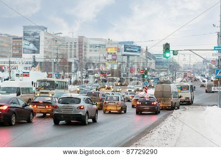 Perm, Russia - Jan 11, 2014: Cars Going On Street. In Perm Region Of About 1 Million Cars