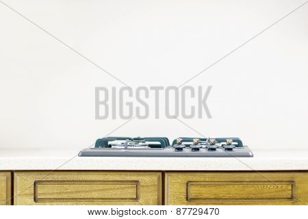 New Black Cooking Gas Surface On Wooden Table In White Simple Kitchen