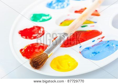 Paintbrush Lies On The Palette With Acrylic Paints