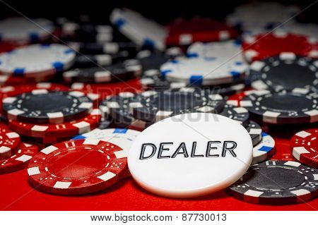 Dealer Button And Chips For Poker