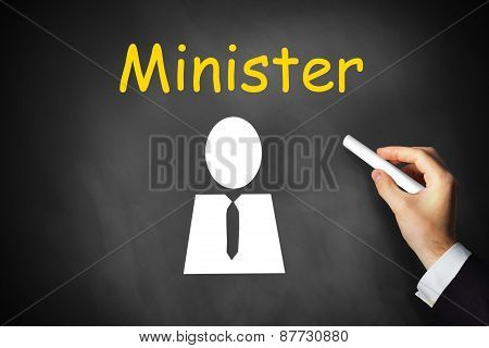 Hand Writing Minister On Black Chalkboard