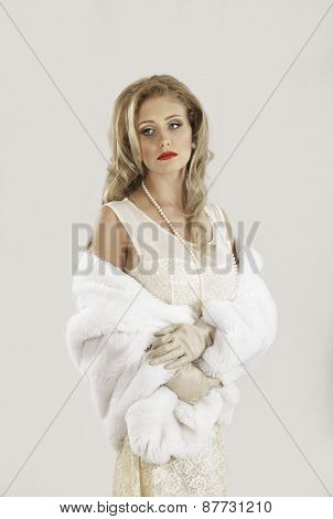 Retro fifties blonde woman with fur coat