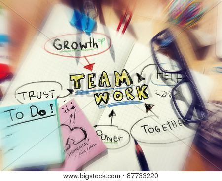 Note Pad and Teamwork Growth Togetherness Concept