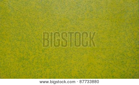 Spray Paint In Yellow Green On Canvas Background