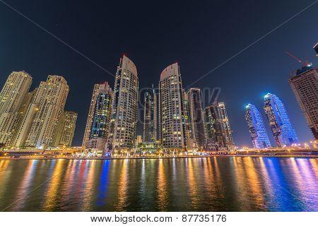 Dubai marina skyscrapers during night hours