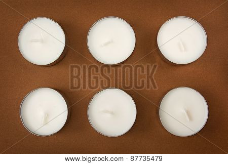 Six Candles On The Brown Background
