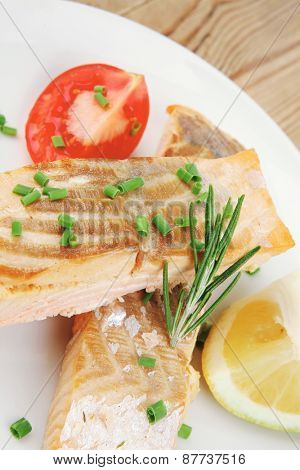 healthy sea food : roasted pink salmon fillet on white dish over wooden table