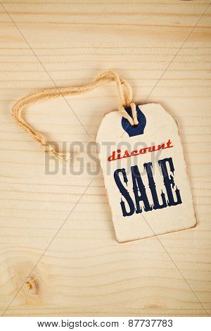 Discount Sale Price Tag Label On Wooden Texture Background