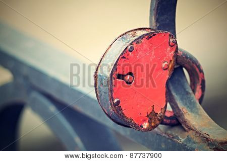 Vintage Padlock On An Iron Fence