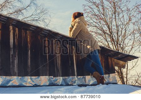 Woman On A Roof