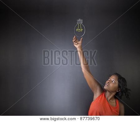 South African Or African American Woman Teacher Or Student Bright Idea Chalk Lightbulb Thinking Blac