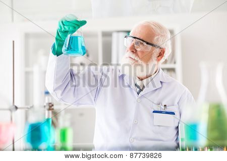 Researcher with a flask