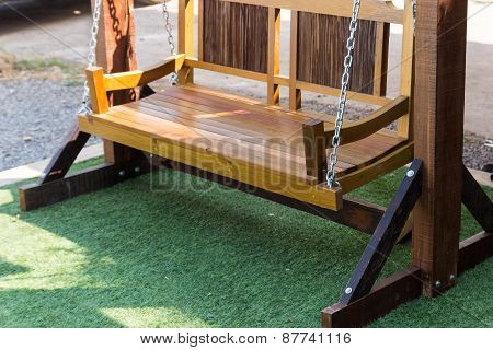 New Wooden Swing On The Artificial Grass