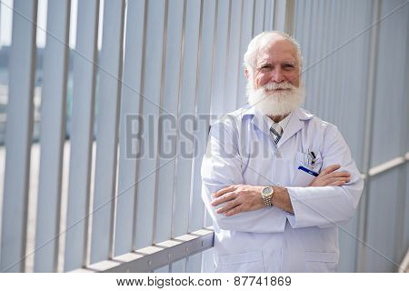 Confident smiling doctor