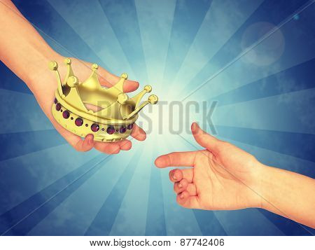 Hand passing gold crown