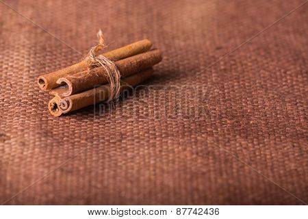Cinnamon. Several cinnamon sticks on the table. spices