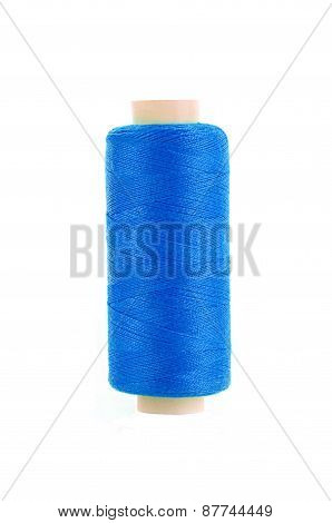 Bobbin Of Blue Thread Isolated On The Background