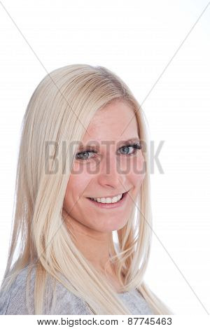 Portrait Of Smiling Blond Woman In White Studio