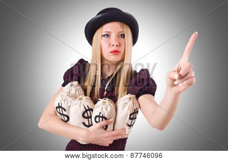Woman gangster with gun and money