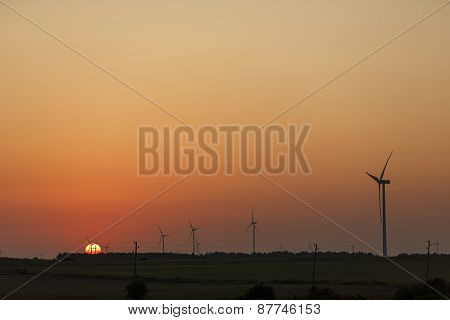 Windmills silhouettes at sunrise