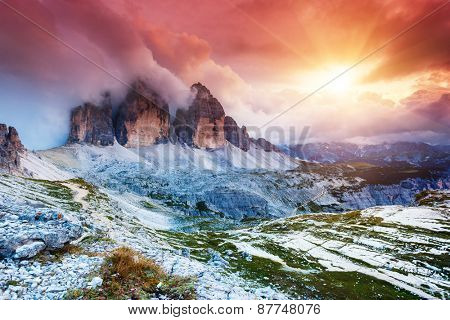 Majestic foggy view of the National Park Tre Cime di Lavaredo with rifugio Locatelli. Dolomites, South Tyrol. Location Auronzo, Italy, Europe. Dramatic scene. Beauty world.