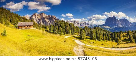 View on the Sassolungo (Langkofel) group, valley Gardena. National Park Dolomites, South Tyrol. Location village Ortisei, S. Cristina and Selva, Italy, Europe. Dramatic unusual scene. Beauty world.
