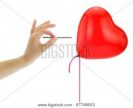 Nail about to pop a heart balloon isolated on white