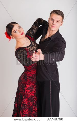 Ballroom dancers dancing. Dancers on a light background