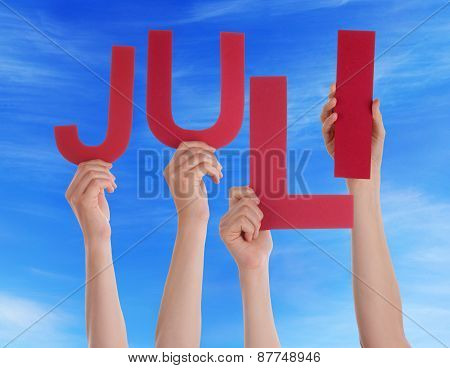 People Holding German Word Juli Means July Blue Sky