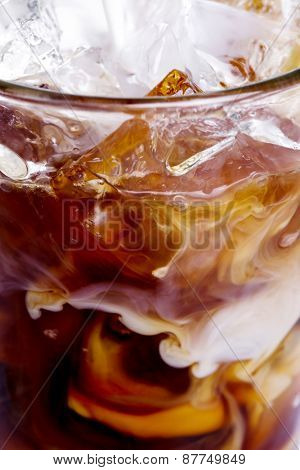 Glass of cold coffee with milk