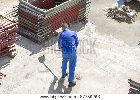 Worker Works With A Shovel, Cleaning Rubble