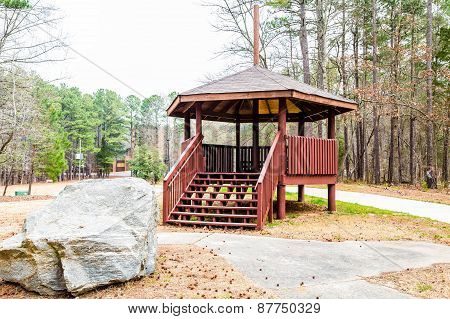 Wood Gazebo By Granite Boulder