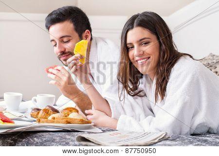 Couple Having Breakfast In Hotel Room.