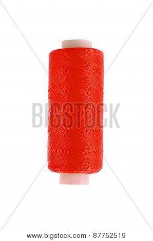 Bobbin Of Red Thread Isolated On The Background