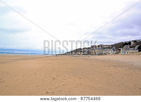 Trouville, low tide at the beach, Normandy (France). The sea beyond