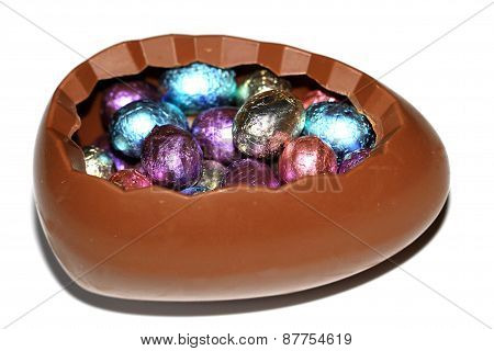 Chocolate egg filled with small eggs
