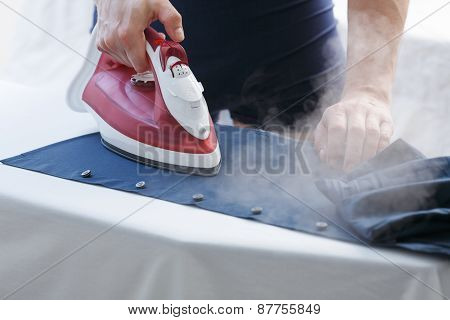 Man Ironing His Shirt