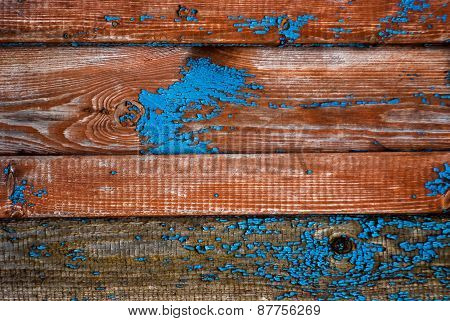 blue chipped paint on the wall of the old boards
