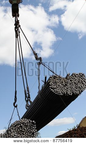 Crane Lifts And Moves A Pack With Metal Reinforcement