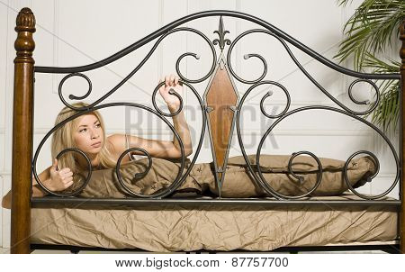crying woman laying in bed depressed
